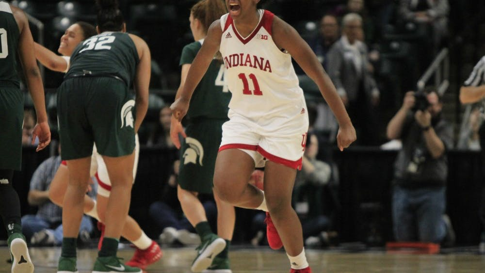Junior forward Kym Royster cheers toward her teammates on the sidelines after the buzzer goes off, making IU successful over Michigan State. IU defeated Michigan State at the beginning of their Big Ten Tournament weekend, 111-109, at Bankers Life Fieldhouse in Indianapolis.