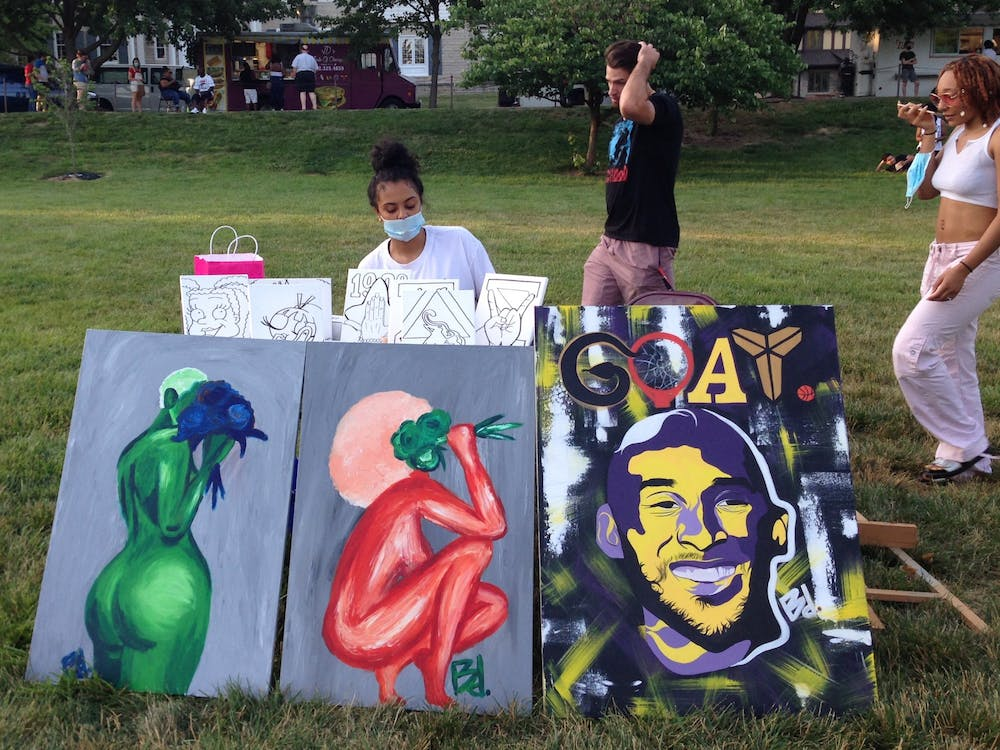 "Bloomington artist Brooklynn Samonee sells her paintings June 26 at the Enough is Enough ""family reunion"" in Dunn Meadow. The event included several artists and local, predominantly Black-owned businesses."