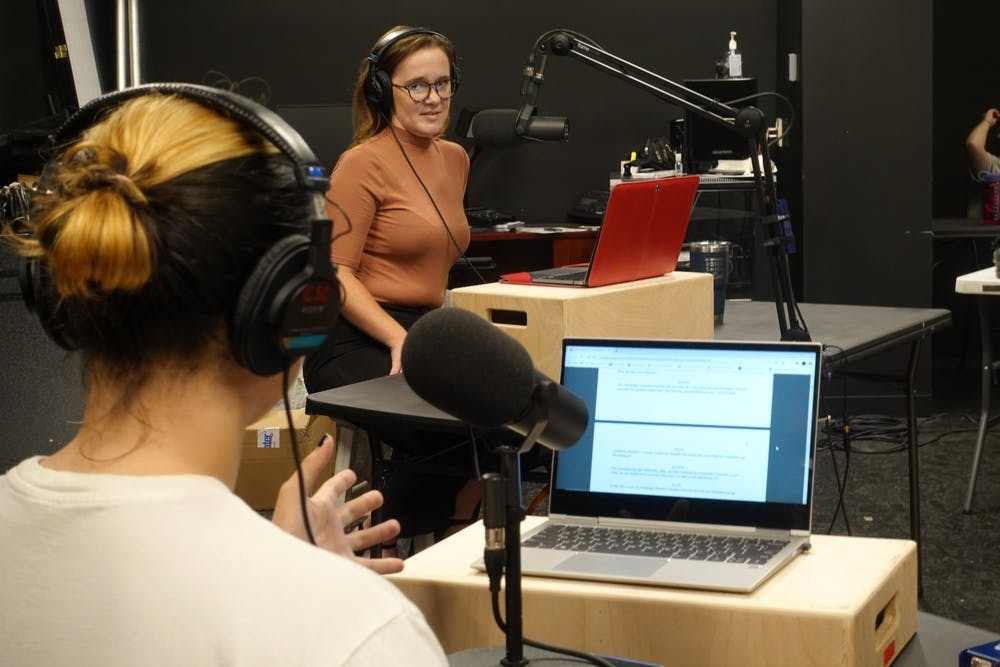 <p>Aubrey Seader and Sean Puent work on recording the Walkabout Radio Plays record skits. Theater companies such as Cardinal Stage have found ways to safely involve people in theater through radio. </p>