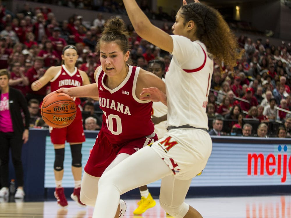 Sophomore Aleksa Gulbe dribbles around a Maryland defender March 7 at Bankers Life Fieldhouse in Indianapolis. No. 4 seed IU lost to No. 1 seed Maryland 66-51 in the semifinals of the Big Ten Tournament.