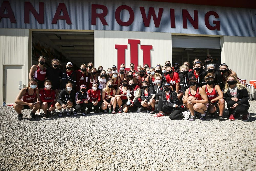 <p>The IU women&#x27;s rowing team poses with its trophy Saturday at Lake Lemon in Bloomington. IU won its fourth consecutive Dale England Cup Sunday at the 12th annual event at Lake Lemon. </p>