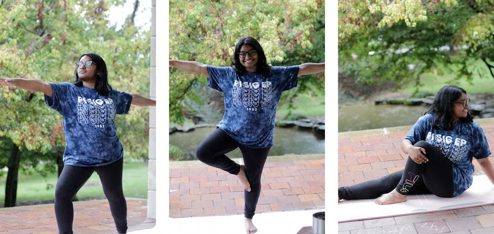 <p>Sophomore Haripriya Jalluri demonstrates yoga poses learned in School of Public Health I190: Yoga 1 on Sept. 22, 2021, outside of Herman B Wells Library. The class takes place twice a week for 50 minutes.</p>