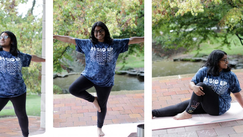 Sophomore Haripriya Jalluri demonstrates yoga poses learned in School of Public Health I190: Yoga 1 on Sept. 22, 2021, outside of Herman B Wells Library. The class takes place twice a week for 50 minutes.