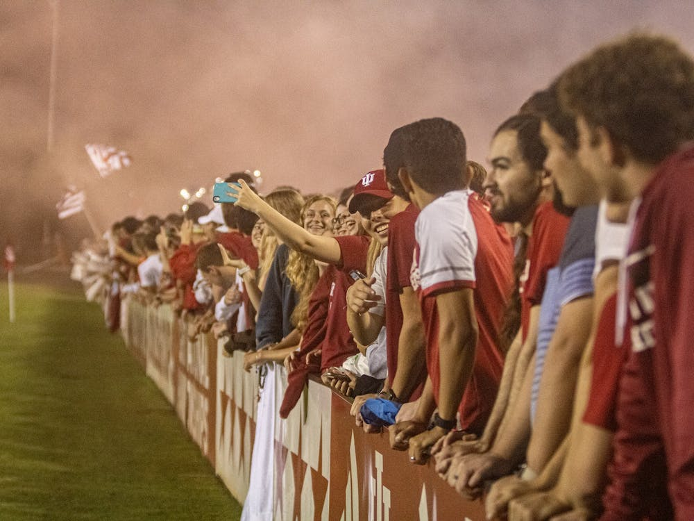 The Hoosier Army supporters' section celebrates IU men's soccer team's lone goal in a victory against Butler  on Aug. 31, 2021, at Bill Armstrong Stadium. The Hoosiers won 1-0 in their home opener against Butler.