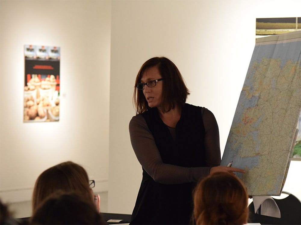 """Artist Cynthia O'Dell points to the area of teh Irish countryside she was in while taking a certain set of photographs during a lecture on Friday in Grunwald Gallery. O'Dell has a photographic exhibition titled """"Messengers of Yesterday"""" on display until Nov. 18."""