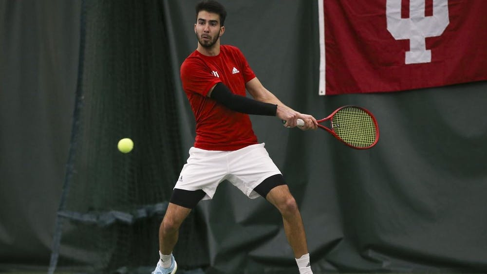 Then-sophomore Luka Vukovic prepares to hit the ball during a match against Wisconsin on March 26, 2021. Along with his partner, senior Carson Haskins, Vukovic won a doubles match against Liberty University on Oct. 8.
