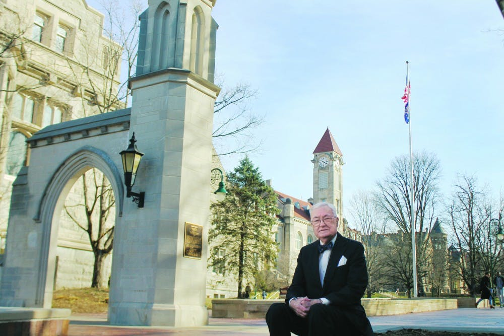 Edson Sample stands in front of the Sample Gates. Sample funded the gates and dedicated them to his parents in June 1987. Before retiring, Sample worked in the Office of Scholarships and Financial Aids at IU for 29 years.