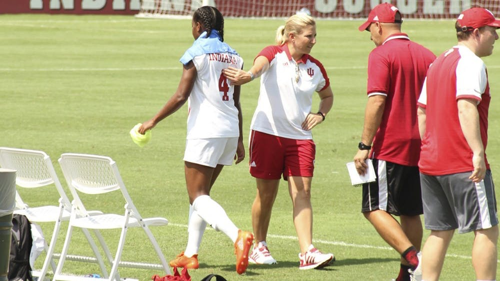Former IU women's soccer Coach Amy Berbary pats Mykayla Brown on the back after a game Aug. 28, 2016 at Bill Armstrong Stadium. IU athletics announced Thursday that Berbary's contract would not be renewed.