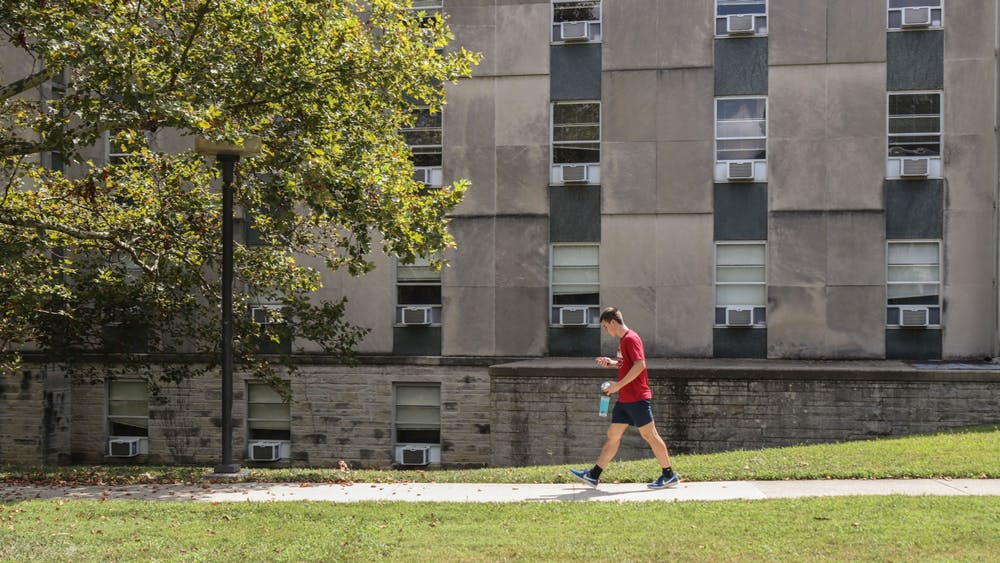 Freshman Colin Altmix walks Aug. 29, 2021, in front of Ashton Residence Center. Only two buildings in the Ashton complex are operating as COVID-19 isolation housing.