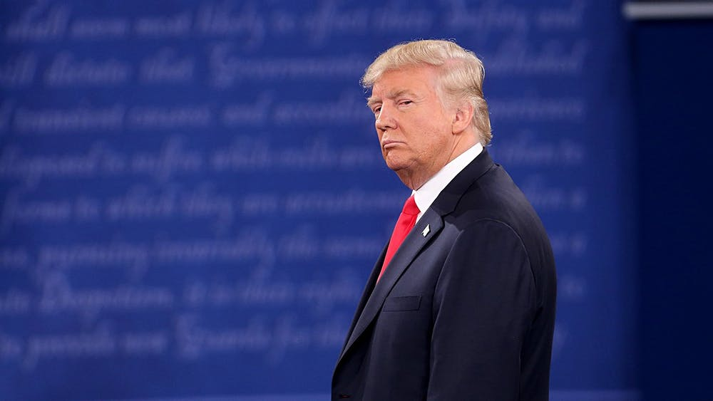 President Donald Trump stands on stage during a presidential debate Oct. 9, 2016, at Washington University in St. Louis, Missouri. An anonymous Big Ten President said President Trump had no say in the decision to play football this fall, despite Trump's claiming he did multiple times, including during Tuesday night's debate.