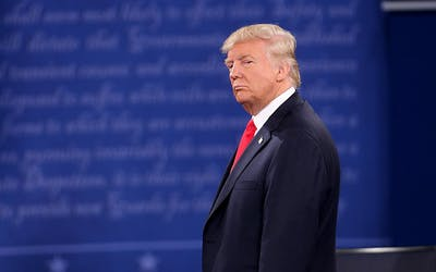 President Donald Trump stands on stage during a presidential debate Oct. 9, 2016, at Washington University in St. Louis, Missouri. Big Ten Presidents say President Trump had no say in the decision to play football this fall, despite Trump's claiming so multiple times, including during Tuesday night's debate.