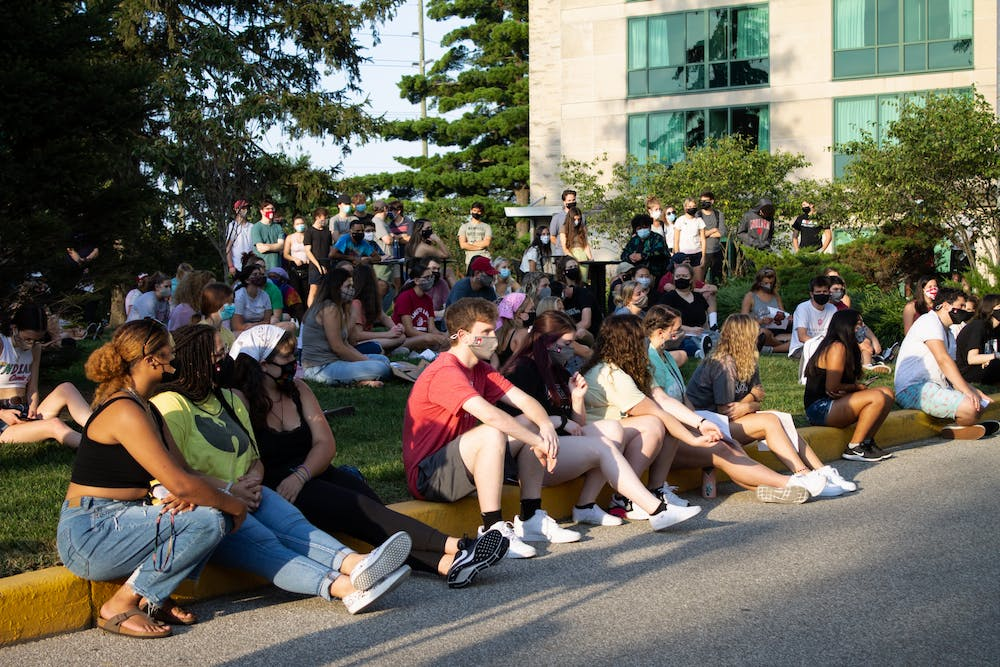<p>Protesters demonstrate during a sit-in protest against sexual assault Sep. 10 outside Eigenmann Residence Hall. The protest was in response to an alleged rape that occurred last weekend, which was reported this week.</p>