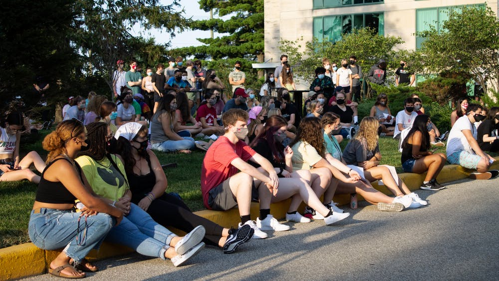Protesters demonstrate during a sit-in protest against sexual assault Sep. 10 outside Eigenmann Residence Hall. The protest was in response to an alleged rape that occurred last weekend, which was reported this week.