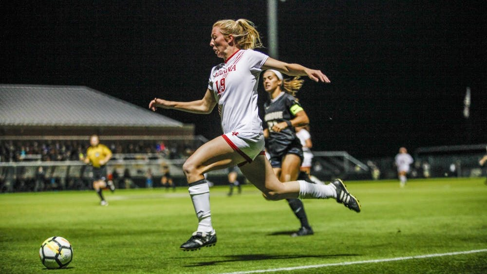 Junior Chandra Davidson runs along the sideline with the ball Sept. 29 at Folk Field. Davidson had two attempted shots against Purdue.