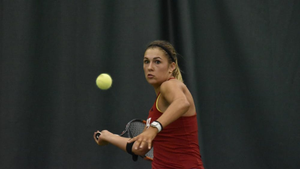 Junior Natalie Whalen eyes a forehand during her 6-1, 6-4 singles loss to the University of Tennessee. IU lost to UT 4-3 on Sunday and are now 8-1 on the season.