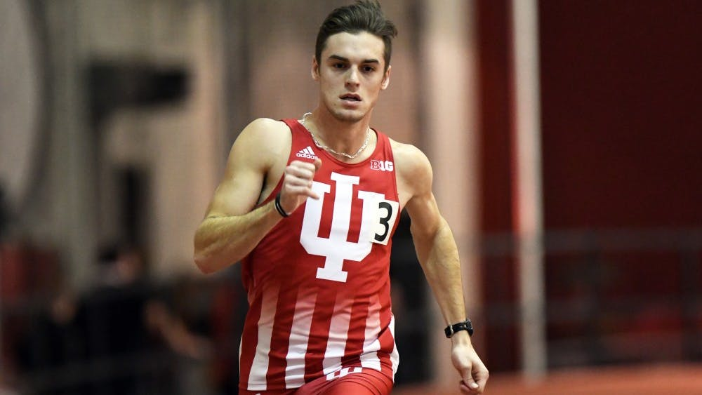 Senior Daniel Kuhn races in the 400m dash against Tennessee on January 6 in Harry Gladstein Fieldhouse. The IU men tied Tennessee, 59-59.