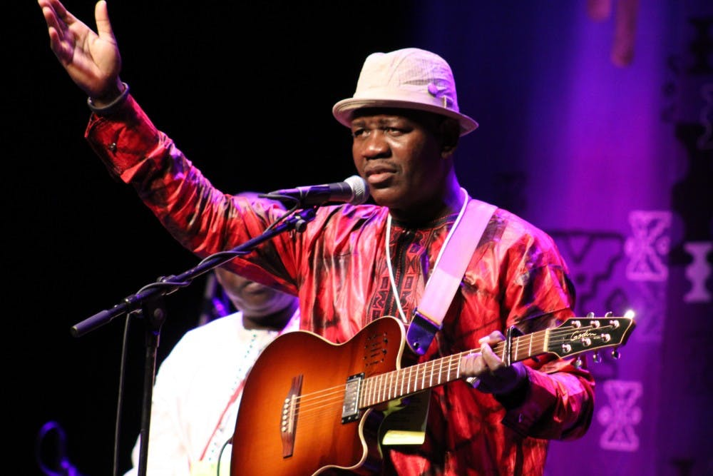 <p>Mamadou Kelly sings one of his native Mali songs Sept. 27 at the Buskirk-Chumley Theater during the Lotus Music and Art Festival kick-off concert. Lotus will continue through Sunday.</p>