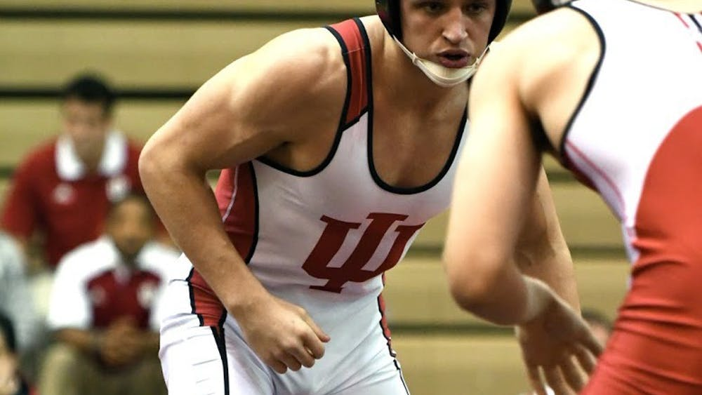 Then-redshirt freshman Jake Kleimola, now a redshirt sophomore, prepares to wrestle against then-freshman Mike Maguire in the 197 lb weight class on Oct. 26, 2017 in University Gym.