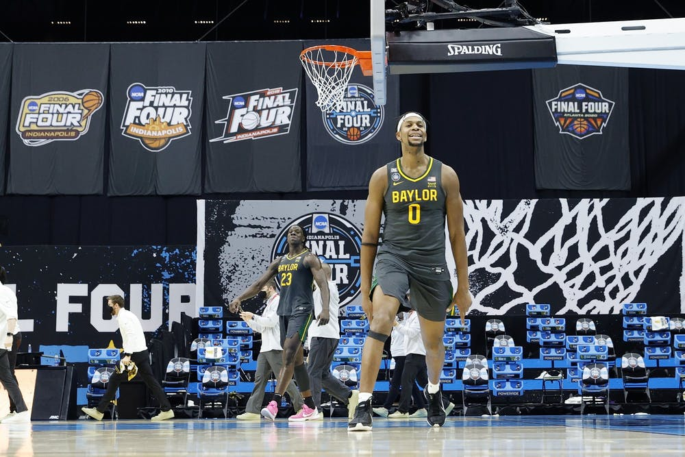 <p>Baylor junior forward Flo Thamba celebrates after winning the NCAA Men&#x27;s Basketball Championship game Monday at Lucas Oil Stadium in Indianapolis. Baylor beat Gonzaga University 86-70. </p>