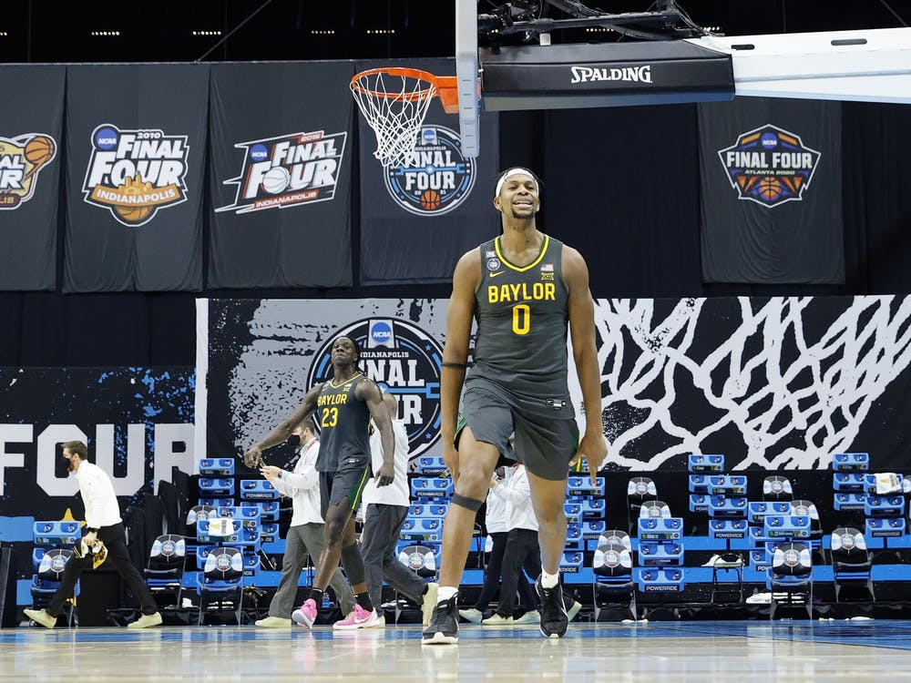 Baylor junior forward Flo Thamba celebrates after winning the NCAA Men's Basketball Championship game Monday at Lucas Oil Stadium in Indianapolis. Baylor beat Gonzaga University 86-70.