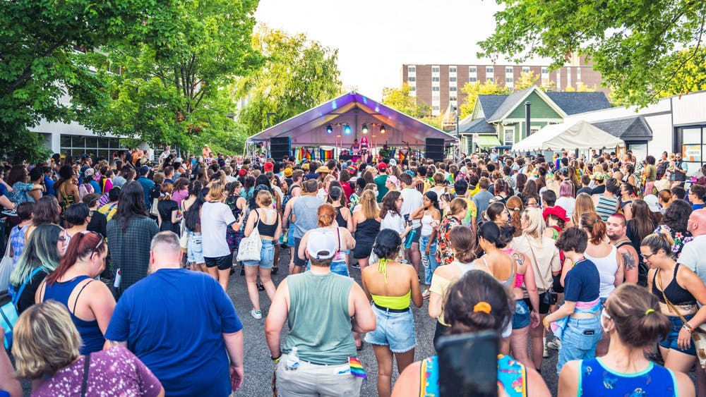 The crowd at Pridefest watches drag performer Arachna perform Aug. 28, 2021, during one of the event's two drag shows on Kirkwood Avenue in Bloomington.