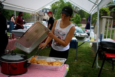 Program assistant Heather Williams makes frybread during the Indian Taco Sale in the backyard of the First Nations Educational and Cultural Center building. All proceeds benefit the Native American Student Association.