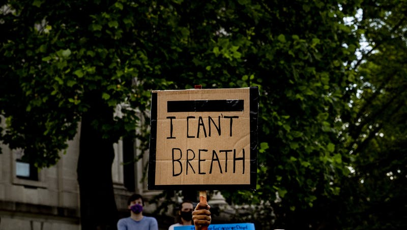"""""""I can't breath,"""" reads a sign May 29 at the Monroe County Courthouse. Protesters joined together after the death of George Floyd."""