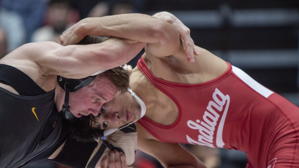 IU freshman Eddie Bolivar wrestles Iowa sophomore Max Murin Jan. 10 in Wilkinson Hall. IU won 19-16 against the University of Maryland on Jan. 26.