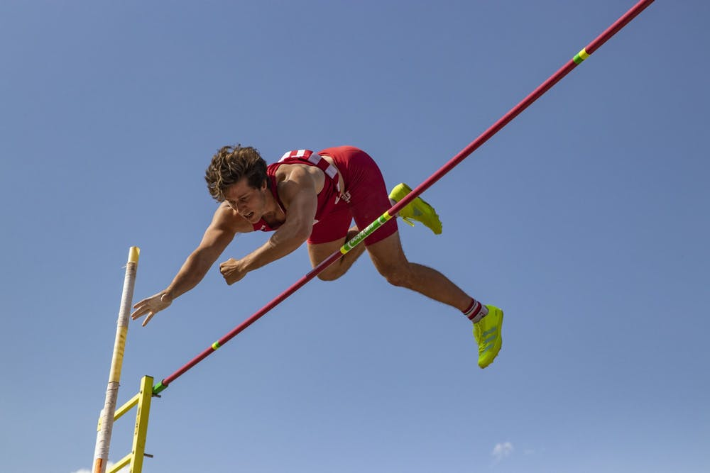<p>Senior Brock Mammoser attempts to clear the standard during the Big Ten Indiana Invitational on Friday at the Robert Haugh Track and Field Complex. Mammoser earned third place in pole vault with a cleared height of 5.05 meters. </p>