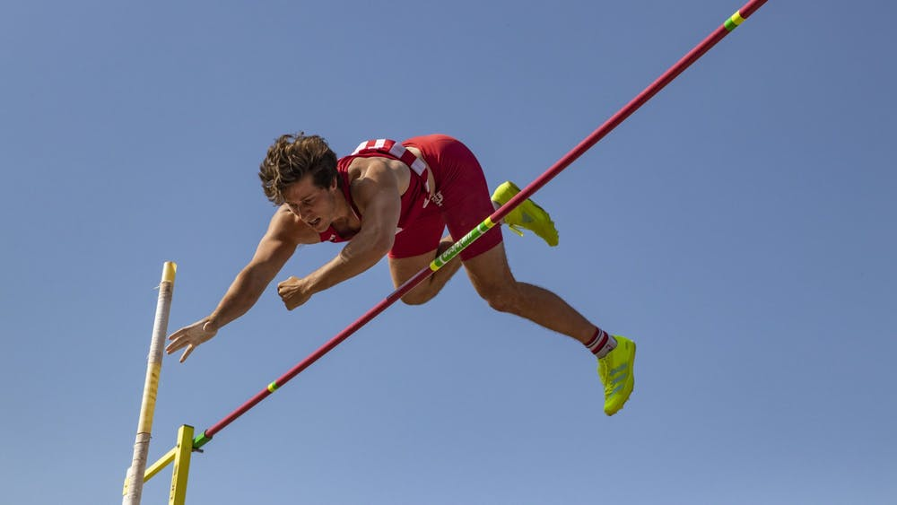 Senior Brock Mammoser attempts to clear the standard during the Big Ten Indiana Invitational on Friday at the Robert Haugh Track and Field Complex. Mammoser earned third place in pole vault with a cleared height of 5.05 meters.