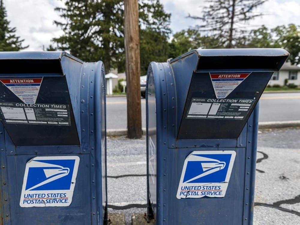 United States Postal Service mail collection boxes sit on a sidewalk in Pennsylvania.