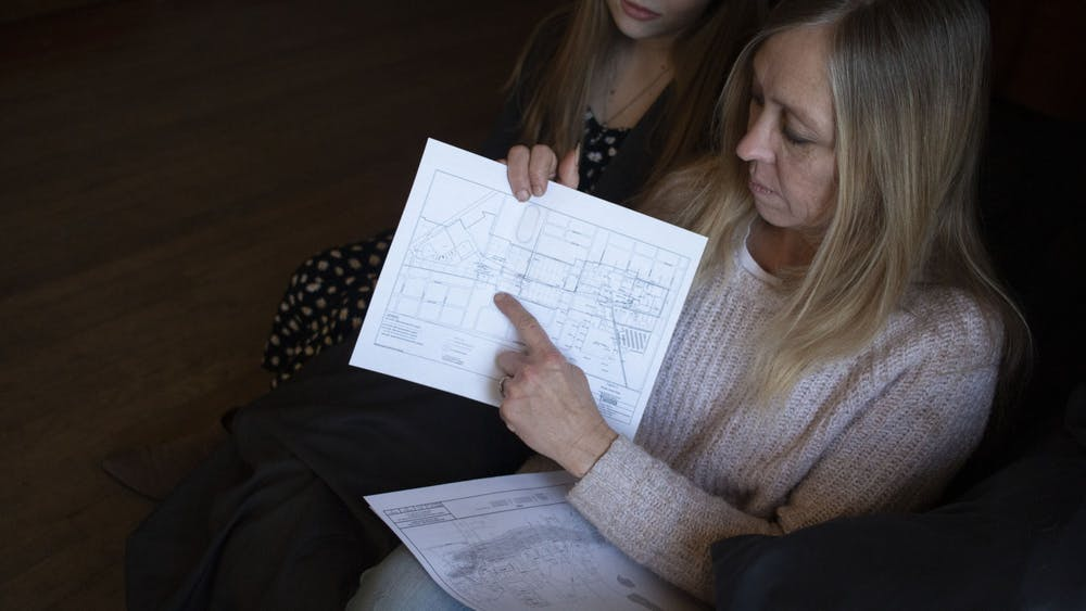 Debbie Corcoran and her daughter Sydney Reed look at chemical plume maps Feb. 16 in their home in Martinsville, Indiana. The chemical plumes are contaminated areas created from improperly disposed chemicals from different companies in the city. One of them runs through their neighborhood.