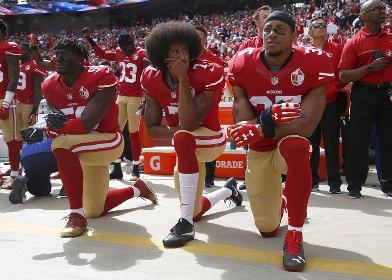 From left, San Francisco 49ers Eli Harold (58), quarterback Colin Kaepernick (7) and Eric Reid (35) kneel during the national anthem before their NFL game against the Dallas Cowboys on Oct. 2, 2016, in Santa Clara, California.