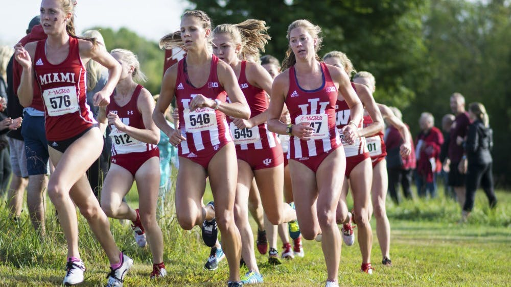 IU women's cross-country team members round a corner of the 5k course at the IU Open in Aug. 2017. The team finished in seventh at the 2018 Nuttycombe Wisconsin Invitational.