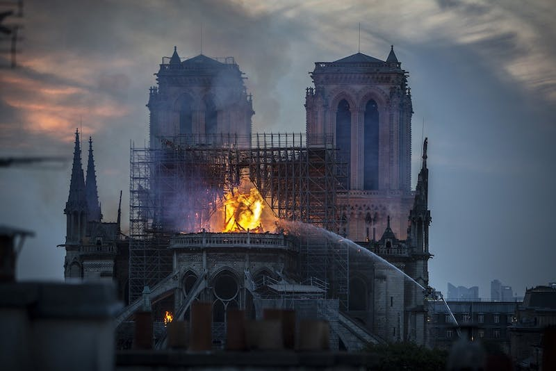 Smoke and flames rise from Notre-Dame Cathedral onApril 15 inParis. A fire broke out on Monday afternoon and quickly spread across the building, collapsing the spire.