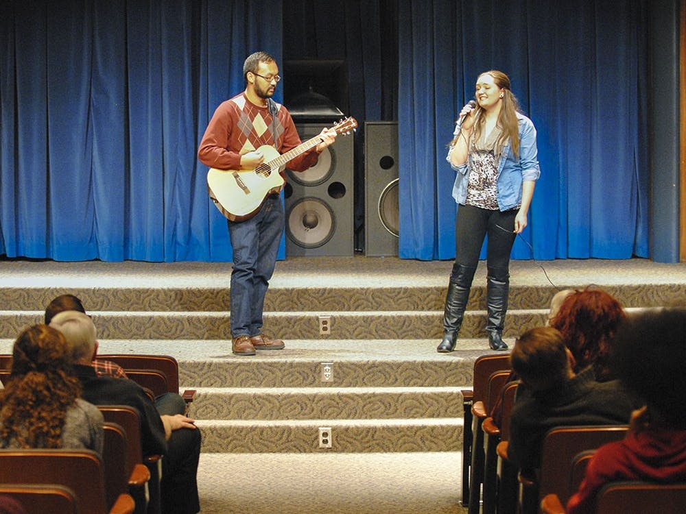 """Emily sings """"You and I"""" by Ingrid Michaelson at the School of Social Work's talent show. After getting off stage, she said she hadn't performed in front of people in years."""