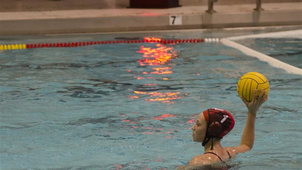 Then-junior goalkeeper Cassie Wyckoff prepares to pass the ball during the Hoosiers' 10-9 victory against Hartwick on Saturday at the Counsilman/Billingsley Aquatic Center. The Association of Collegiate Water Polo Coaches announced Wednesday that Wyckoff, along with teammate senior Jakie Kohli, earned honorable mention All-American status.