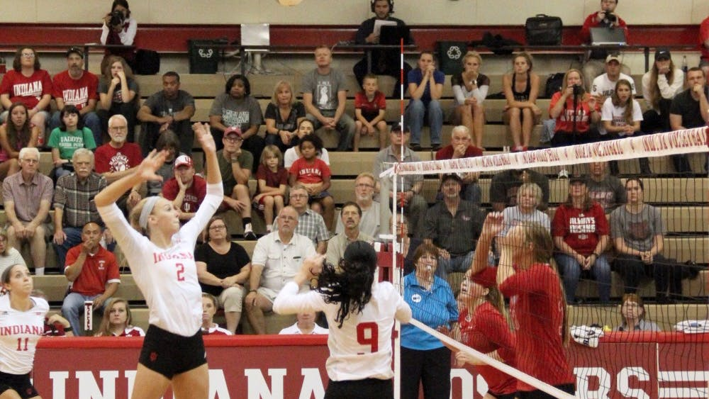 Hayden Huybers, Indiana University Volleyball middle blocker, gets ready to smash the ball as they compete against Arkansas State Red Wolves Friday at IU University Gym.
