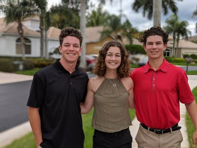 Emily Isaacman poses at Thanksgiving with younger brothers Max, 17, and Zach, 14. Max and Zach both attend Torrey Pines High School in San Diego.