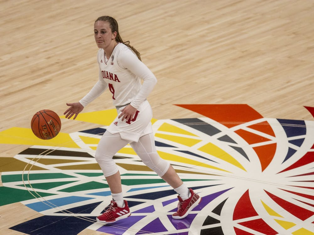 Senior guard Nicole Cardaño-Hillary dribbles the ball across half court March 11 in the quarterfinals of the Big Ten women's basketball tournament at Bankers Life Fieldhouse in Indianapolis. IU defeated Virginia Commonwealth University 63-32 Tuesday in San Antonio, Texas.