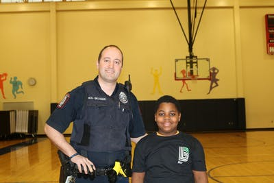IU Police Department  officer Ryan Skaggs poses Jan. 23 with Kalael, 9. Big Brothers Big Sisters connects children with older community members to serve as positive role models.