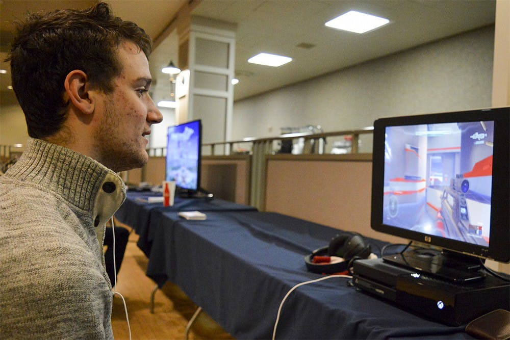 Nationally Ranked LAN party player Joey Leclear enjoys an online game of Halo 5 during UITS' video game conference Saturday evening at the IMU. Leclear commented on the shift from counsel gaming to PC gaming by stating that it is quickly becoming the new norm for gamers worldwide.