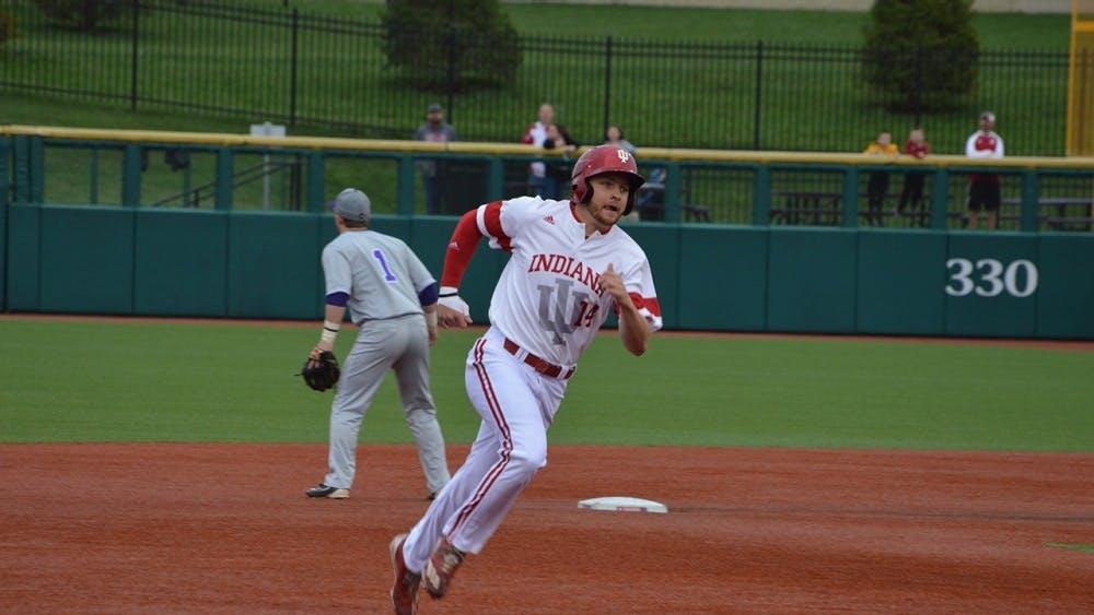 Then-sophomore infielder Matt Lloyd, now-senior, runs to third base after his teammate, Tony Butler, hits a grounder toward left field during the 2017 season.