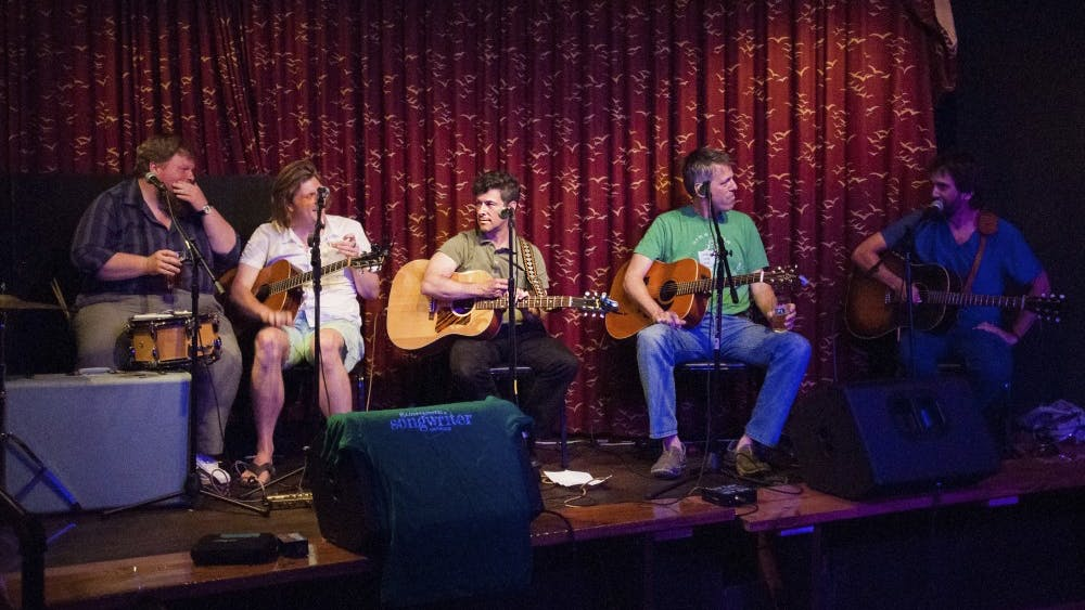 Artists performs at the Bloomington Songwriters Showcase in 2016 at Bear's Place. The showcase gives local artists the opportunity to perform their works in public.