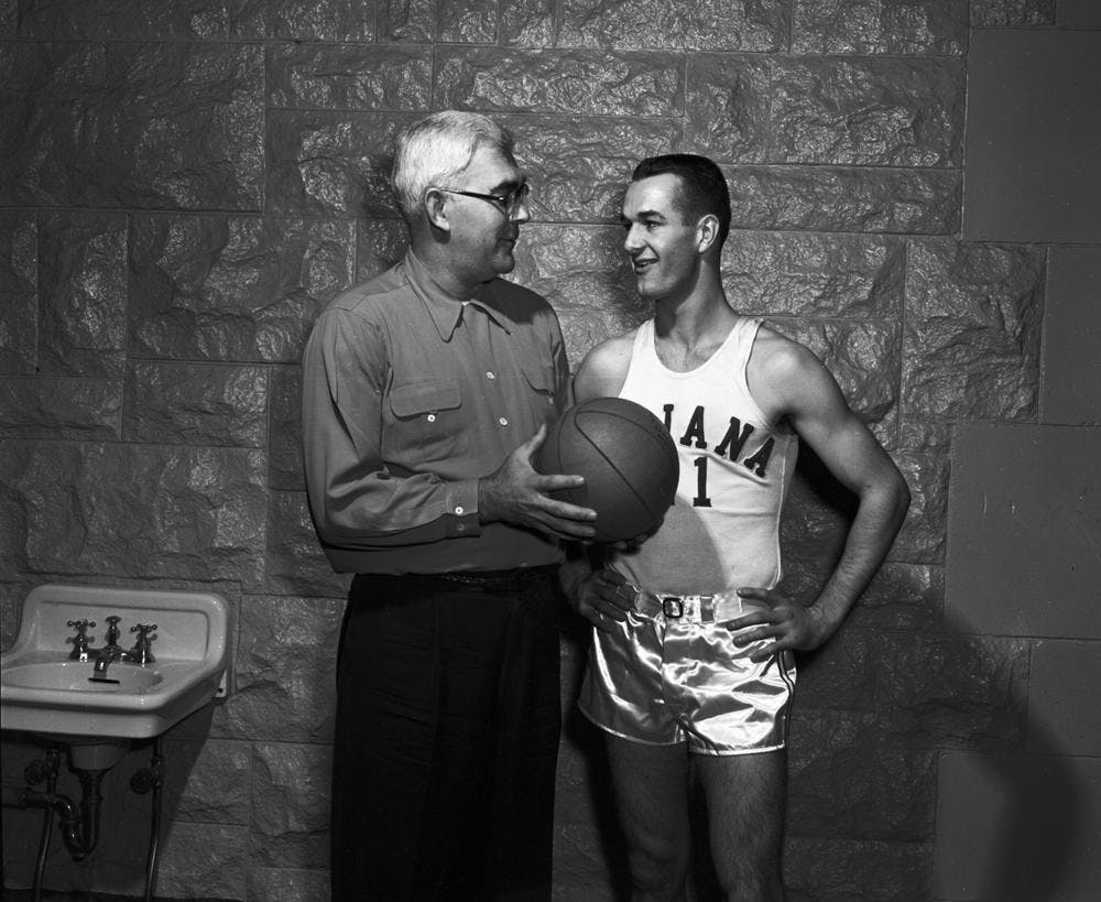 <p>Branch McCracken, left, talks with Bobby &quot;Slick&quot; Leonard, right, Nov. 29, 1952, in Bloomington. Leonard, a legendary Indiana Pacers coach and former IU men&#x27;s basketball player, died Tuesday at 88.</p>