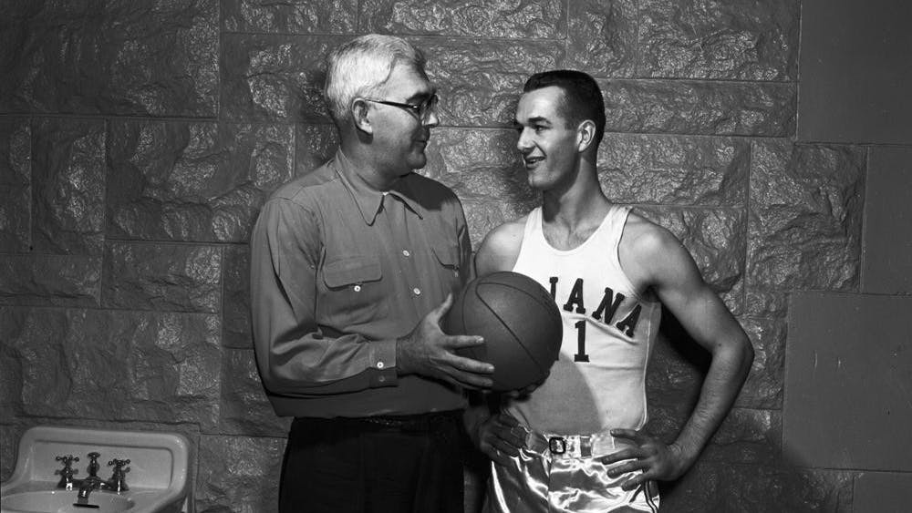 "Branch McCracken, left, talks with Bobby ""Slick"" Leonard, right, Nov. 29, 1952, in Bloomington. Leonard, a legendary Indiana Pacers coach and former IU men's basketball player, died Tuesday at 88."