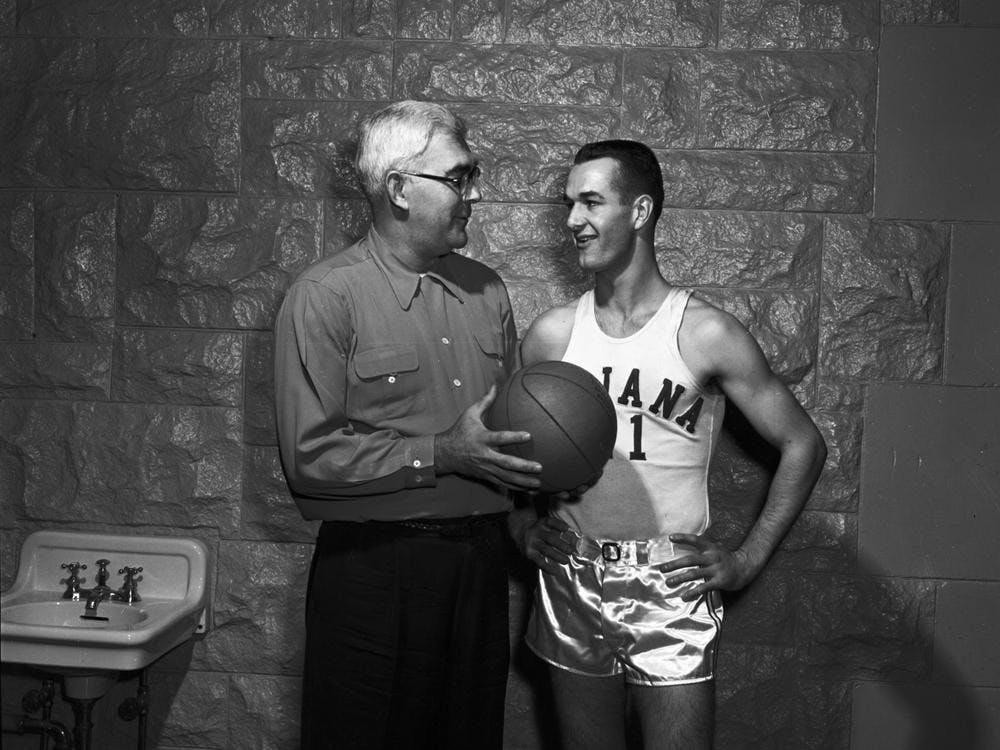 """Branch McCracken, left, talks with Bobby """"Slick"""" Leonard, right, Nov. 29, 1952, in Bloomington. Leonard, a legendary Indiana Pacers coach and former IU men's basketball player, died Tuesday at 88."""