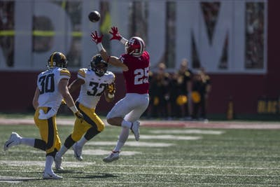 Senior wide receiver Luke Timian receives a pass during IU's 42-16 loss to Iowa on Oct. 13 at Memorial Stadium. The game against Iowa was IU's fourth in Big Ten play.
