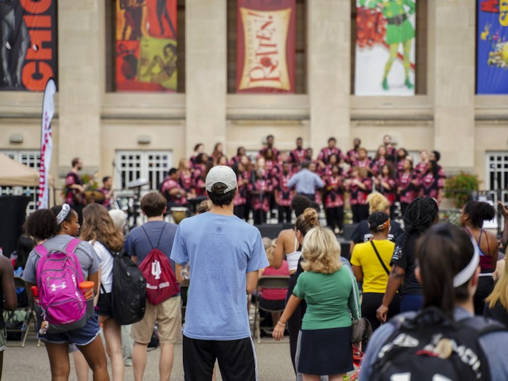 """The African American Choral Ensemble performs during the First Thursdays Festival Sept. 6 at the Fine Arts Plaza. The group performed during the 25th Anniversary of the """"Potpourri of the Arts"""" concert."""