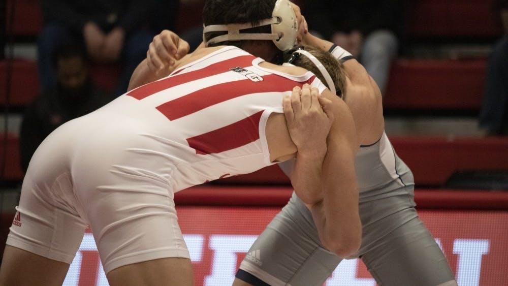 Redshirt freshman Kyle Lugis wrestles University of Tennessee at Chattanooga junior Chris Debien on Feb. 24 in Wilkinson Hall. IU wrestling will start its 2019-20 season Nov. 2 at the Michigan State Open in East Lansing, Michigan.